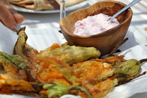 Fried zucchini flowers and pickled onion sauce