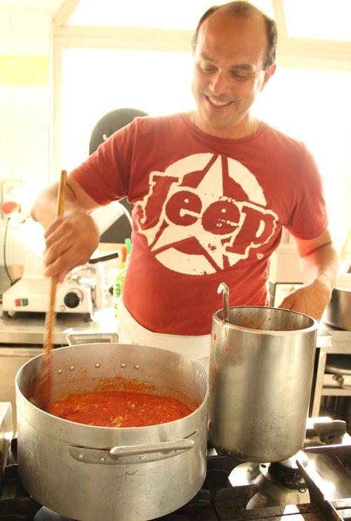 Maurizio stirs the pots